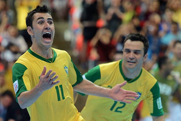 Neto of Brazil (L) celebrates with teammates after scoring a goal against Spain on the way to Brazil winning the final match of the FIFA Futsal World Cup 2012 in Bangkok on November 18, 2012. AFP PHOTO/PORNCHAI KITTIWONGSAKUL (Photo credit should read PORNCHAI KITTIWONGSAKUL/AFP/Getty Images)